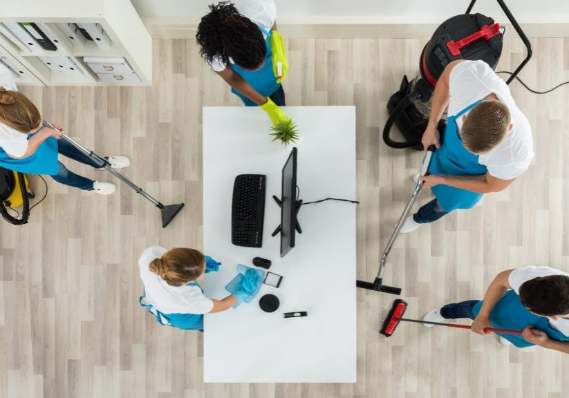 Canva-Janitors-Cleaning-The-Office-With-Cleaning-Equipments